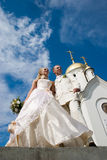 Newlyweds. Newlyweds in front of church Royalty Free Stock Photography