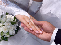 Newlyweds. Hands of happy young newlyweds royalty free stock images