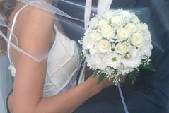 Newlyweds And Wedding Bouquet Royalty Free Stock Images