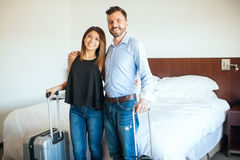 Newlyweds arriving to their hotel room Royalty Free Stock Photos