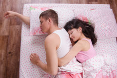Newlyweds are asleep in bed Royalty Free Stock Image