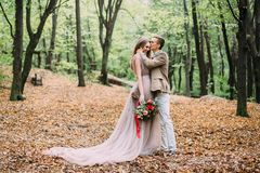 Newlyweds in an autumn romantic forest. Wedding ceremony outdoors. royalty free stock photos