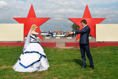 Newlyweds on a background of red stars Royalty Free Stock Photo