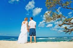 Newlyweds in bali. Happy wedding couple on the beach Stock Photography
