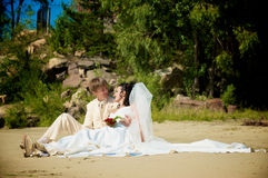 Newlyweds on the beach Royalty Free Stock Images