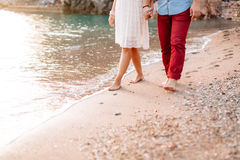 Newlyweds on the beach. Legs close-up royalty free stock photo
