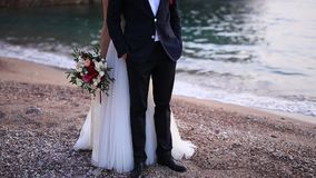 Newlyweds on the beach. The queen`s beach in the villa is a milo stock video