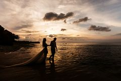 Newlyweds on the beach royalty free stock photography