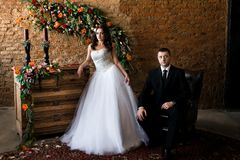 Newlyweds in a beautiful room full of flowers royalty free stock images