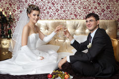 Newlyweds in bedroom Stock Photos