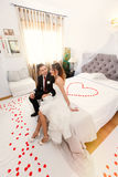 Newlyweds in bedroom with heart Royalty Free Stock Photos