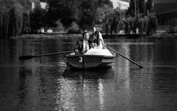 Newlyweds in boat Stock Image