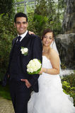 Newlyweds in botanical garden Royalty Free Stock Photos