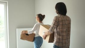 Newlyweds bought property. A young couple examines his new home. Moving after repair, buying a new home. Man and woman