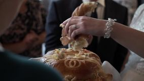 Newlyweds breaking traditional wedding bread stock footage