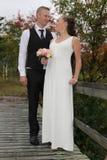 Newlyweds on a bridge Royalty Free Stock Image