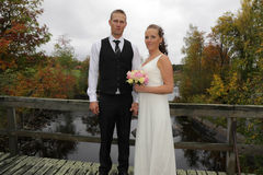 Newlyweds on a bridge Royalty Free Stock Photos