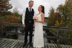 Newlyweds on a bridge Stock Photo
