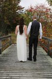 Newlyweds on a bridge Stock Photography
