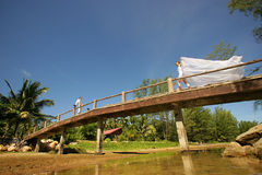 Newlyweds on the brige. The newly married couple mitting on the brige Royalty Free Stock Images