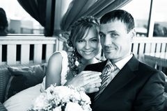 Newlyweds in cafe Royalty Free Stock Photography