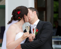 Newlyweds celebrate there wedding with a kiss Royalty Free Stock Image