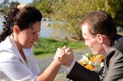 Newlyweds challenge Royalty Free Stock Images