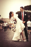 Newlyweds in the city. Happy married couple. Royalty Free Stock Photos