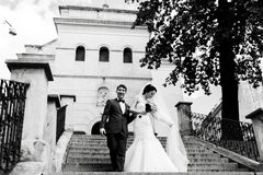 Newlyweds come down downstairs from a church Royalty Free Stock Images
