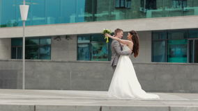 Newlyweds coming up to each other and kissing stock footage