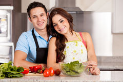 Newlyweds cooking dinner together Stock Image