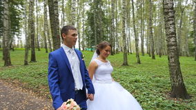 Newlyweds,couple of happy newlyweds on a walk in summer park stock footage
