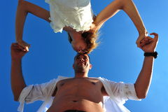 Newlyweds couple, honeymoon dance. Cute couple of newlyweds in a head to head dance royalty free stock images