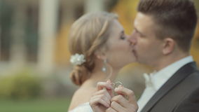 Newlyweds couple in love show their gold wedding stock video footage