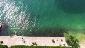 Newlyweds on the docks in the city of Ljuta, in the Bay of Kotor. Montenegro. Aerial Photo drone stock footage