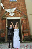 Newlyweds with  doves Stock Photo