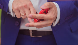 Newlyweds dressed lock heart as a token of love Stock Photos