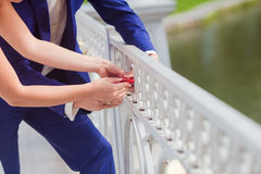 Newlyweds dressed lock heart as a token of love Stock Images