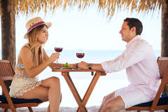 Newlyweds drinking wine at the beach Royalty Free Stock Photo