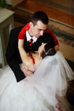 Newlyweds embraces. On the stais royalty free stock photography