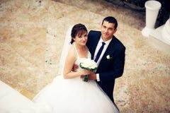 Newlyweds embraces Royalty Free Stock Photo
