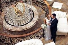 Newlyweds embraces Royalty Free Stock Images