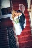 Newlyweds embraces Stock Photos