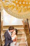 Newlyweds embraces indoors Stock Photo