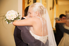 Newlyweds embracing Stock Photography