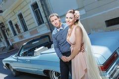 Newlyweds embracing Royalty Free Stock Photos