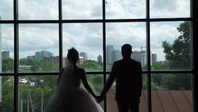Newlyweds enjoying view from their new apartments stock footage