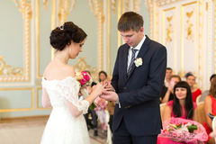 The newlyweds exchanged rings Stock Photography
