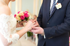 The newlyweds exchanged rings Stock Photos