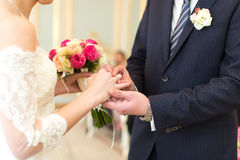 The newlyweds exchanged rings Stock Image